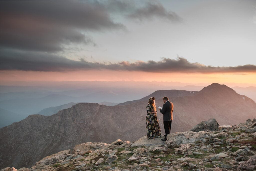 Bride and Groom say vows at top of Mt. Evans at sunset at Colorado elopement by Denver Wedding Photographer Jennie Crate Photographer