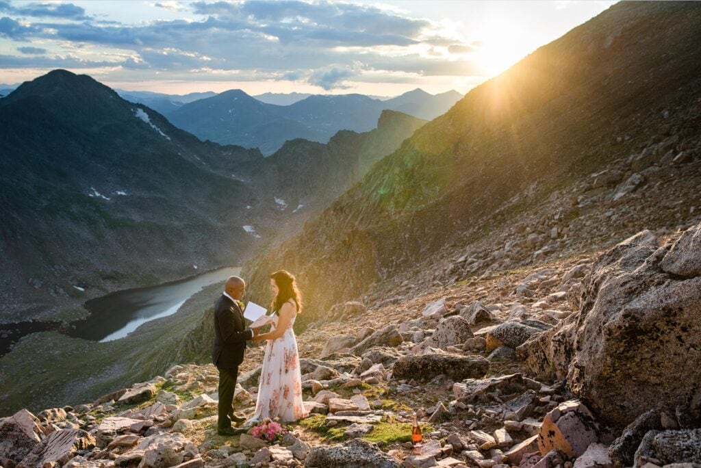 bride and groom say vows on top of Mt. Evans at Colorado elopement by Denver Wedding Photographer Jennie Crate Photographer