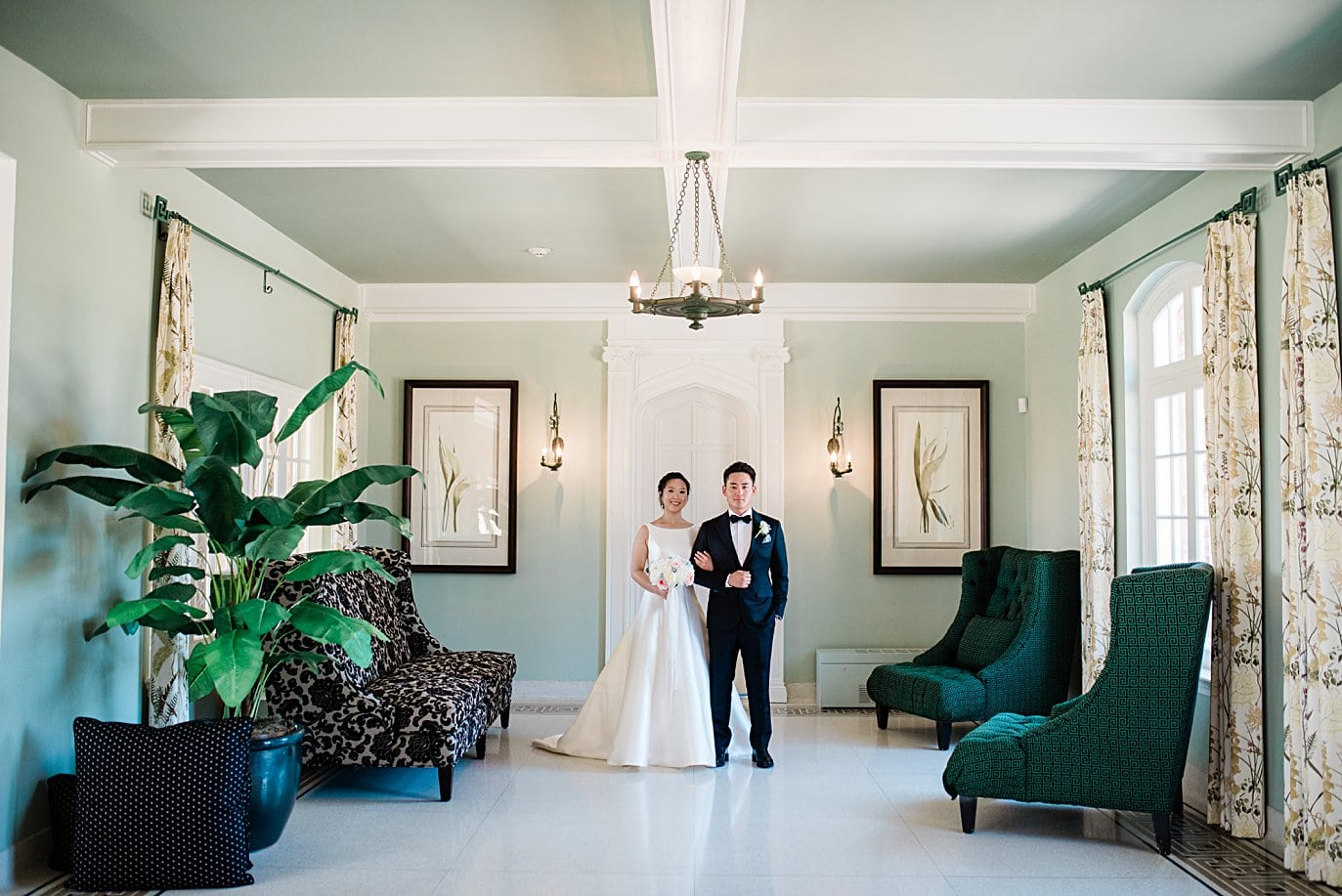 bride and groom in the solarium at Highlands Ranch Mansion wedding by Denver wedding photographer Jennie Crate