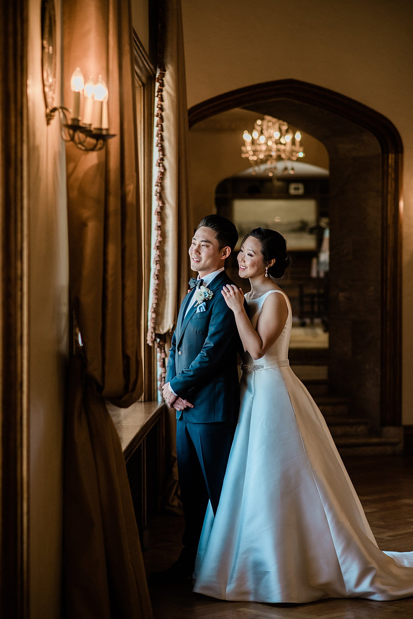 bride and groom by window in parlor at Highlands Ranch Mansion wedding by Denver wedding photographer Jennie Crate