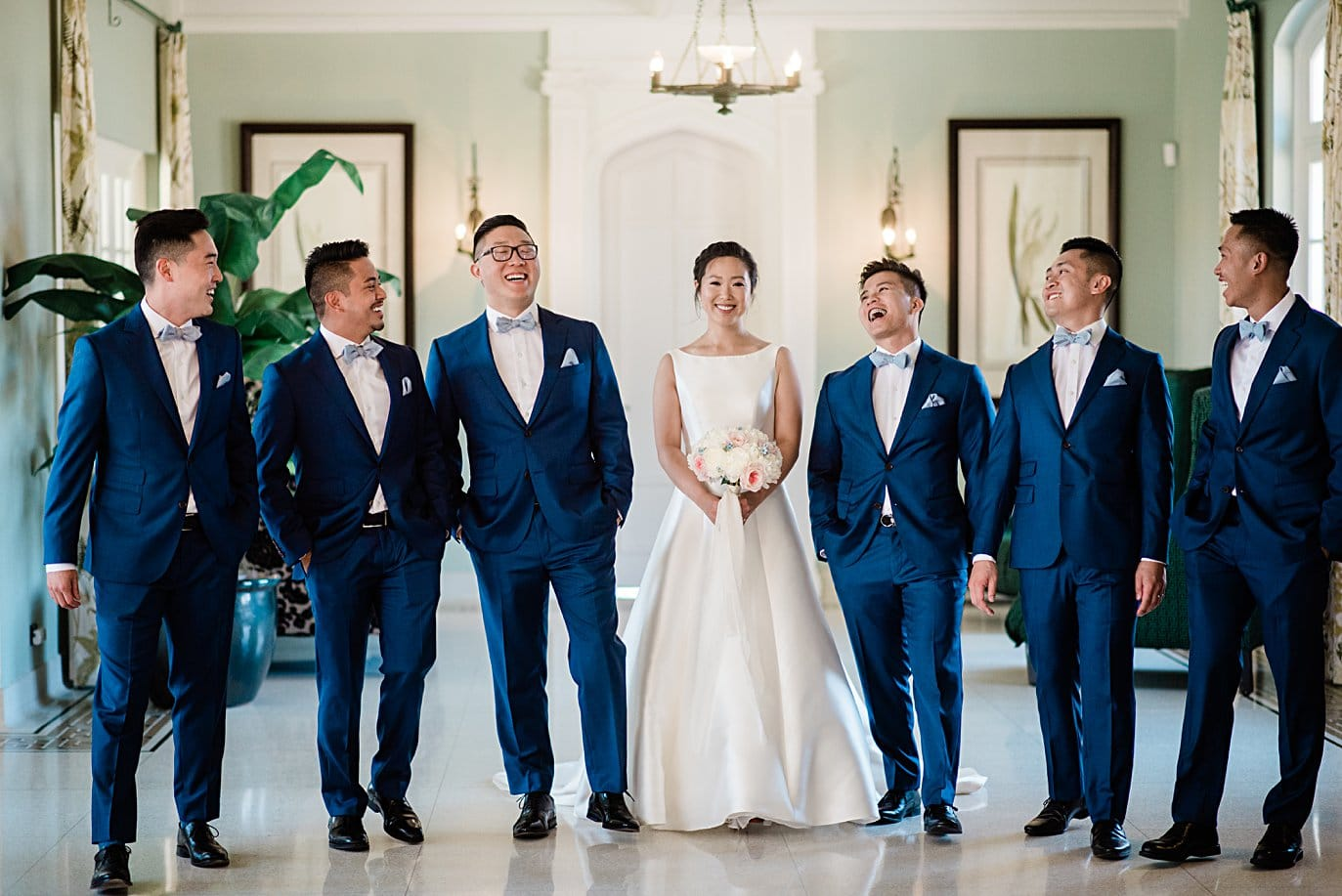 bride and groomsmen in blue suits at Highlands Ranch Mansion wedding by Golden wedding photographer Jennie Crate