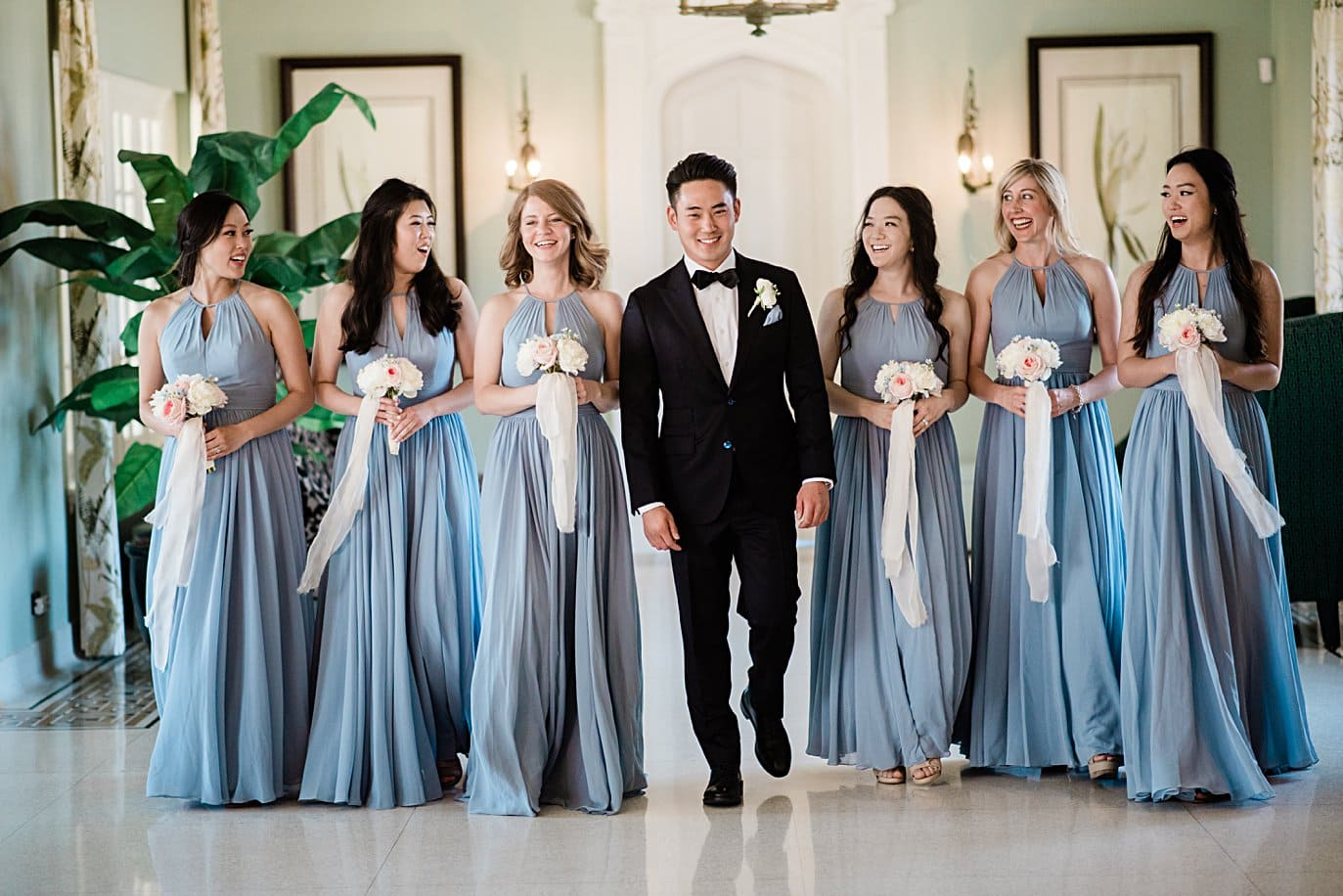 groom and bridesmaids in light blue bridesmaids dresses at Highlands Ranch Mansion wedding by Golden wedding photographer Jennie Crate