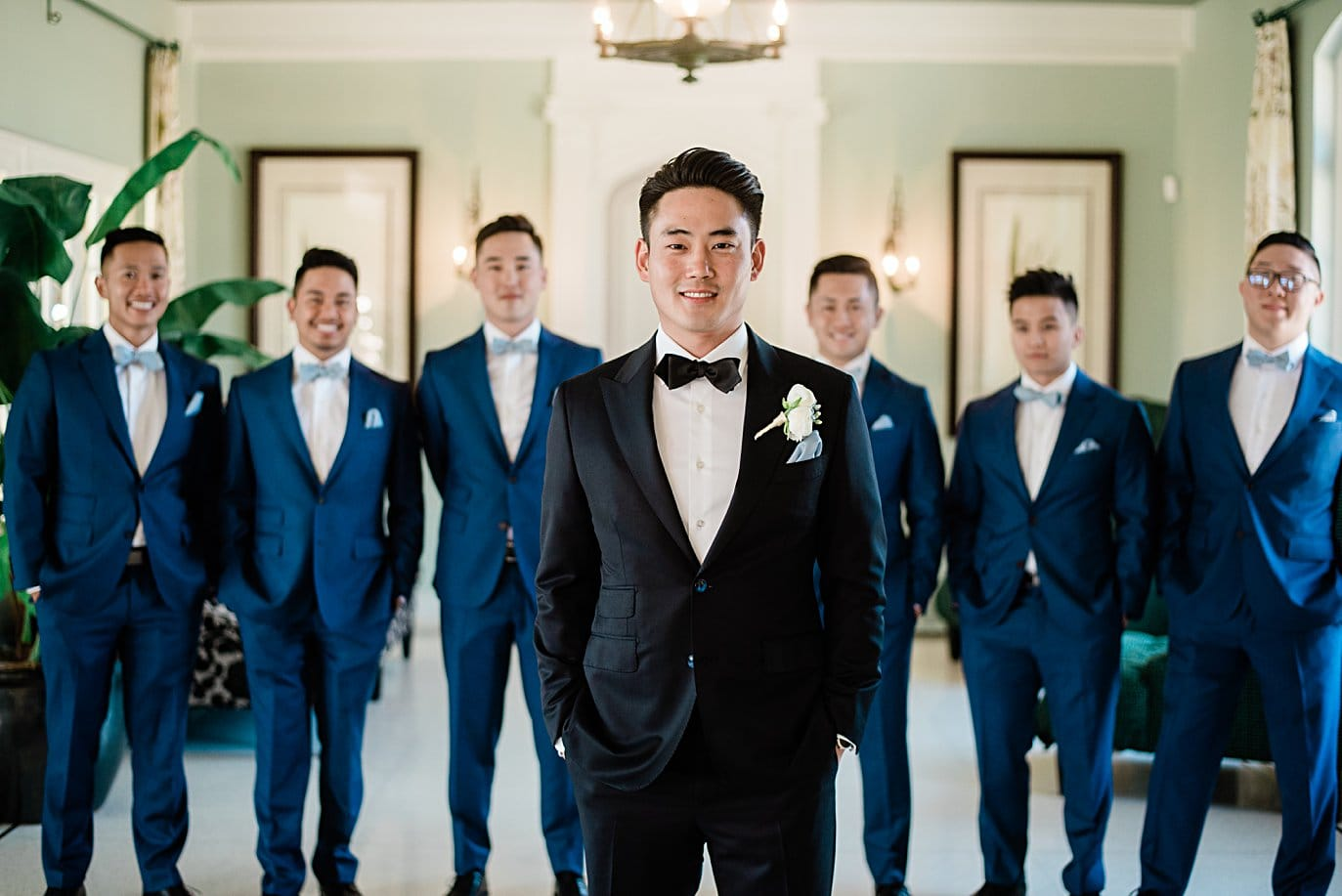 broom in black tux with groomsmen in blue suit and bowties at Highlands Ranch Mansion wedding by Golden wedding photographer Jennie Crate