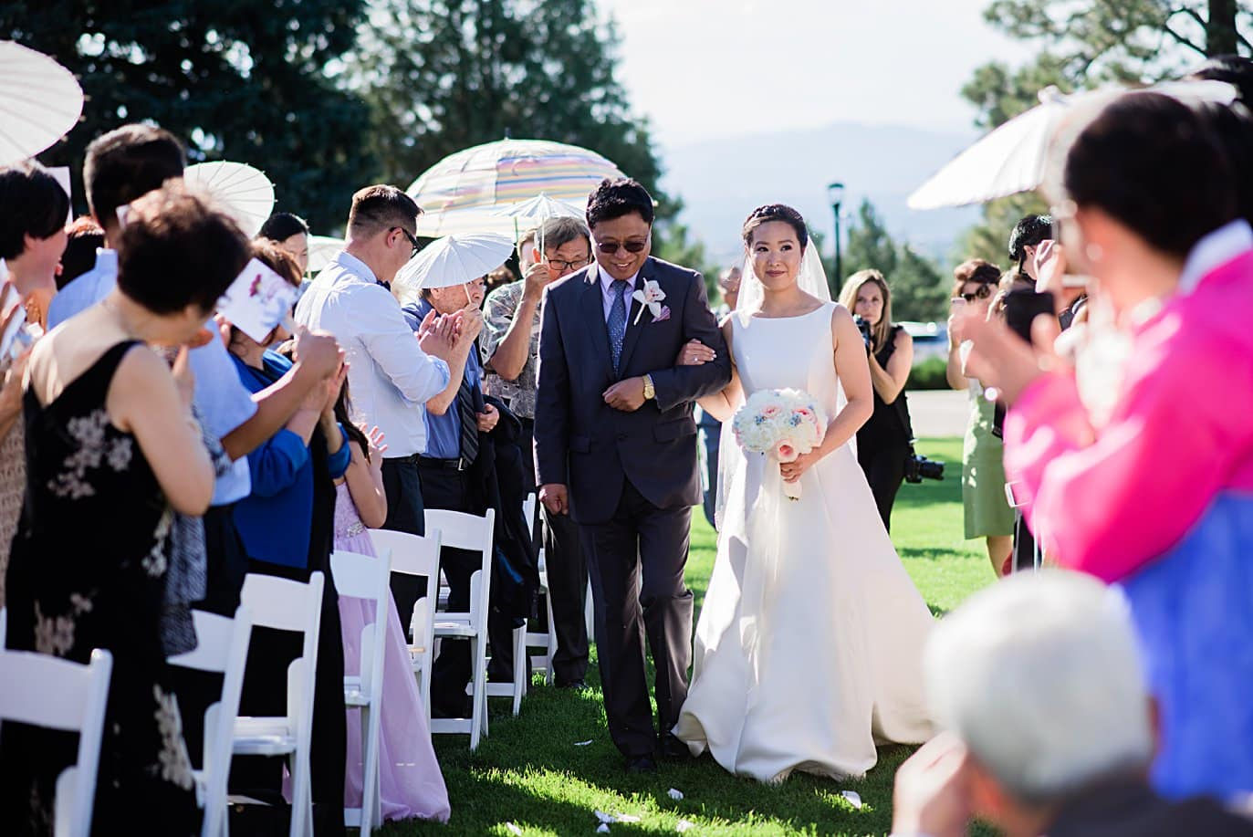 bride and father walk down aisle at Highlands Ranch Mansion wedding by Boulder wedding photographer Jennie Crate