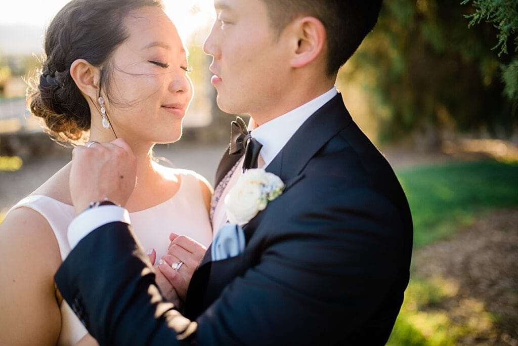 romantic sunset bride and groom portrait on front lawn at Highlands Ranch Mansion wedding by Boulder wedding photographer Jennie Crate