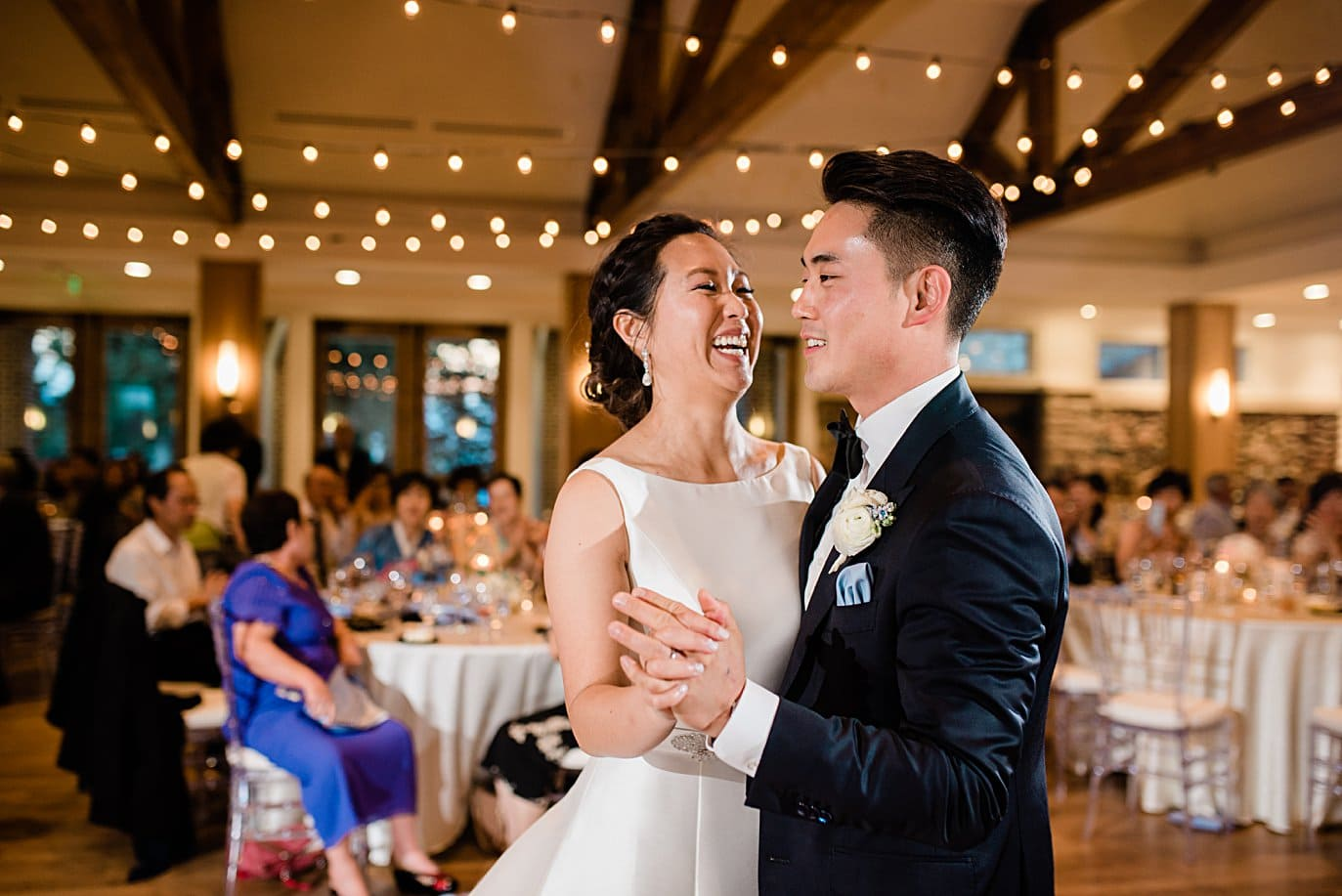 bride and groom first dance inside at Highlands Ranch Mansion wedding by Boulder wedding photographer Jennie Crate