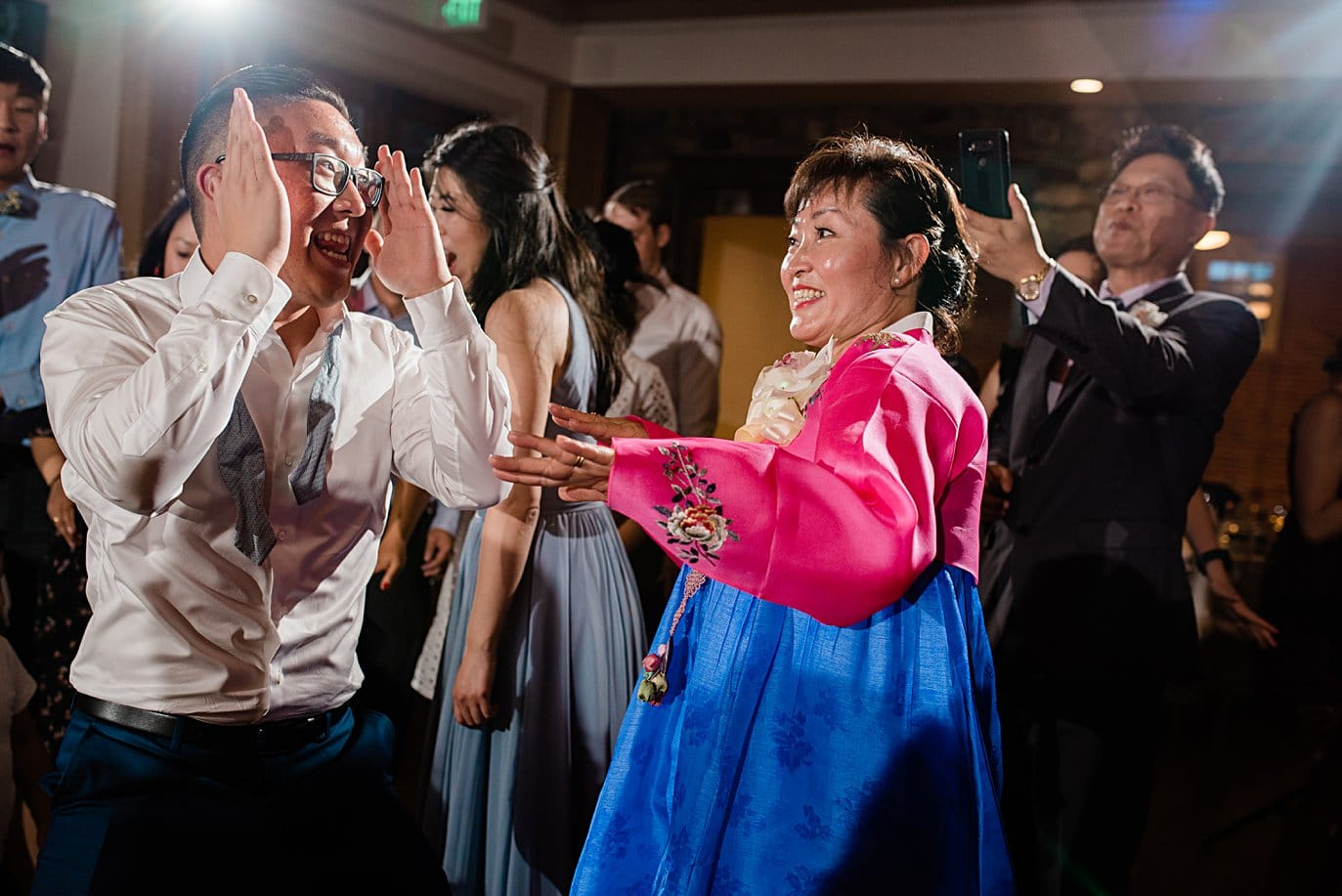 bride's mom dancing at wedding reception at Highlands Ranch Mansion wedding by Boulder wedding photographer Jennie Crate