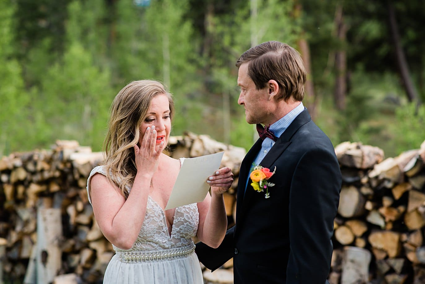 bride cries while reading vows at private property Golden elopement by Golden wedding photographer Jennie Crate