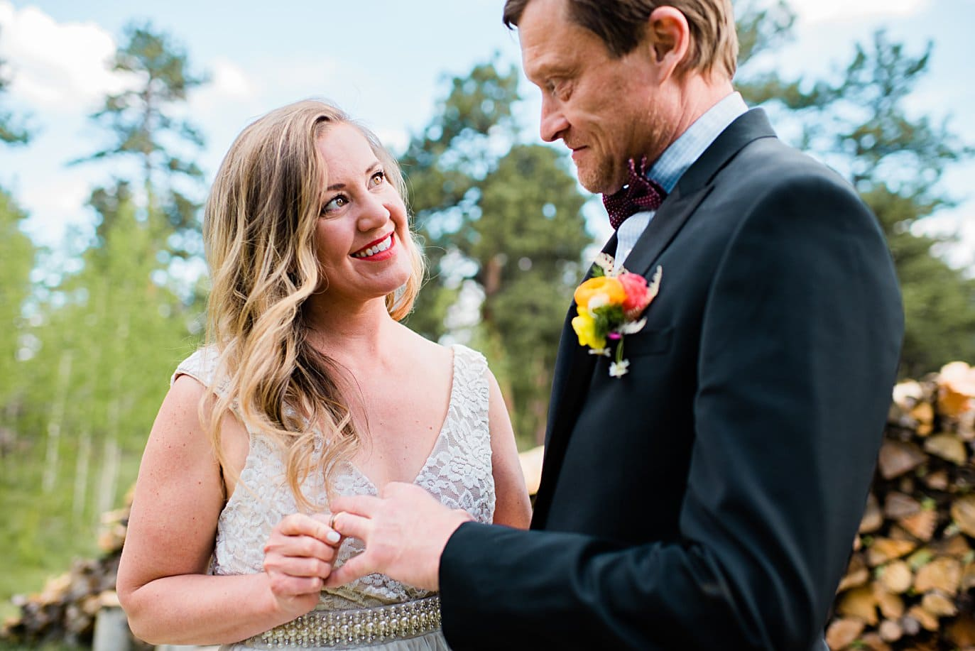 ring exchange during wedding vows at private property Golden elopement by Golden wedding photographer Jennie Crate
