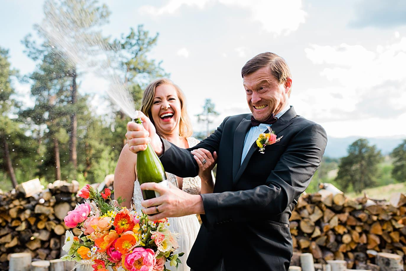 bride and groom pop champagne after wedding ceremony at private Golden elopement by Boulder elopement photographer Jennie Crate