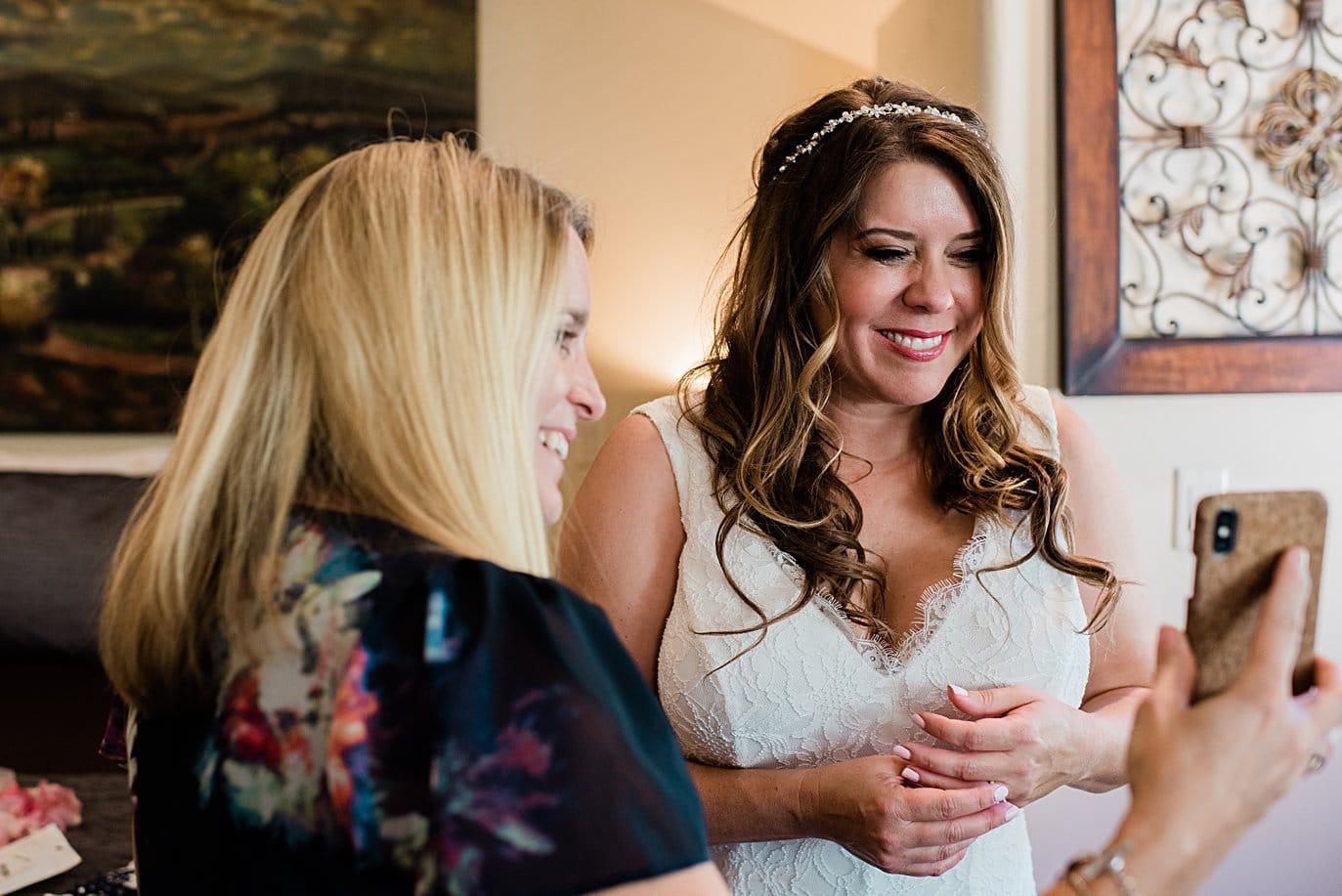 bride facetiming parents during COVID wedding at Lily Lake Elopement by Estes Park elopement photographer Jennie Crate