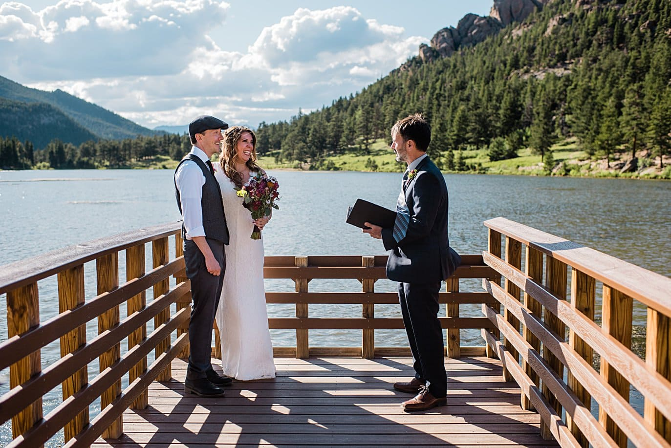 bride and groom say vows at Lily Lake Elopement by Estes Park elopement photographer Jennie Crate