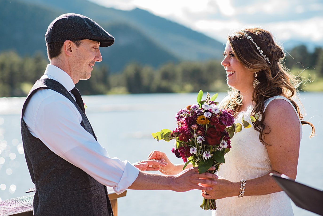 bride and groom ring exchange at Lily Lake Elopement by Estes Park elopement photographer Jennie Crate