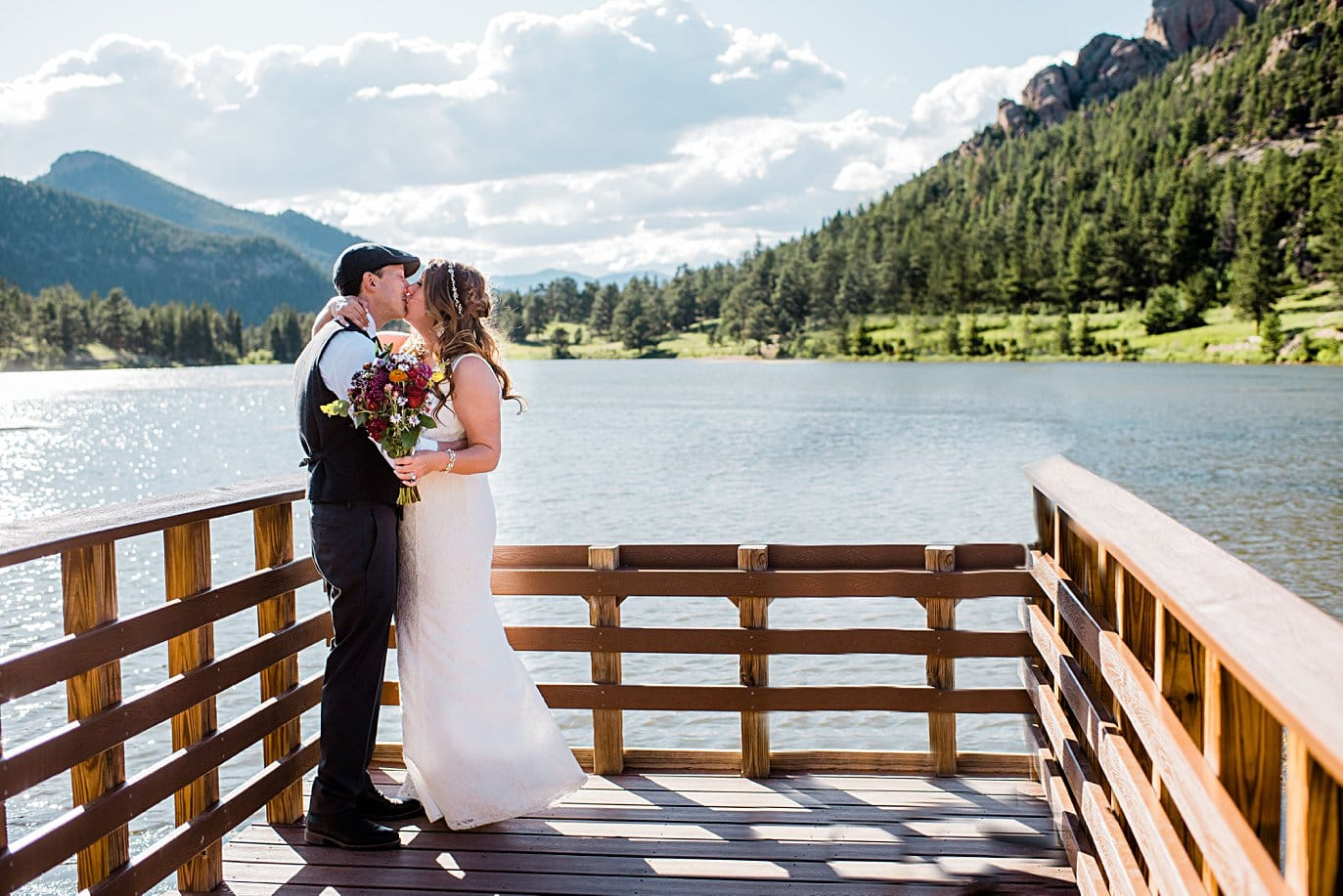bride and groom first kiss at Lily Lake Elopement by Estes Park elopement photographer Jennie Crate