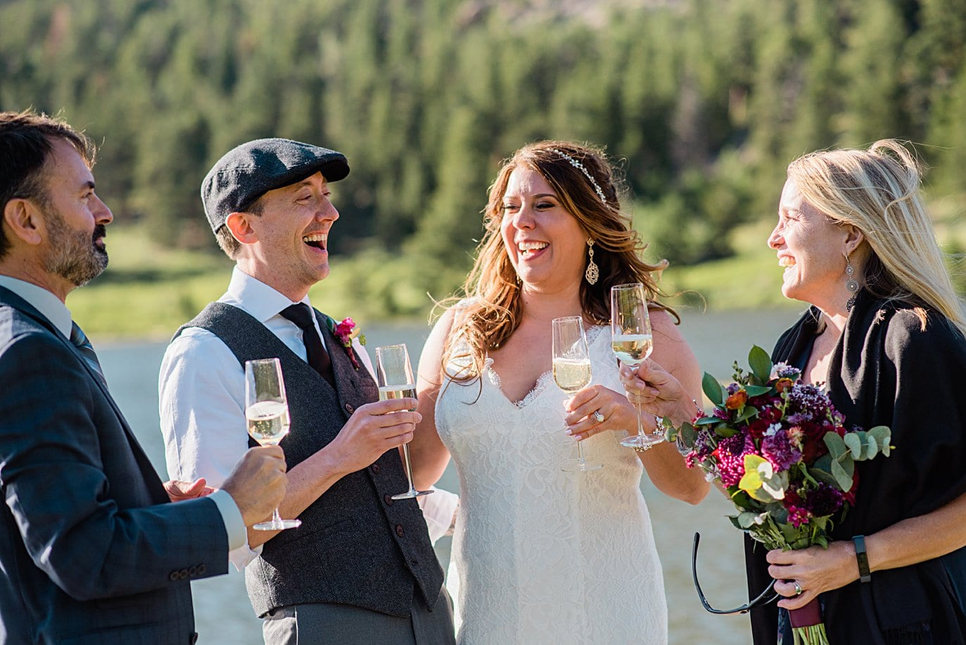 bride and groom and friends share champagne at Lily Lake Elopement by Estes Park elopement photographer Jennie Crate