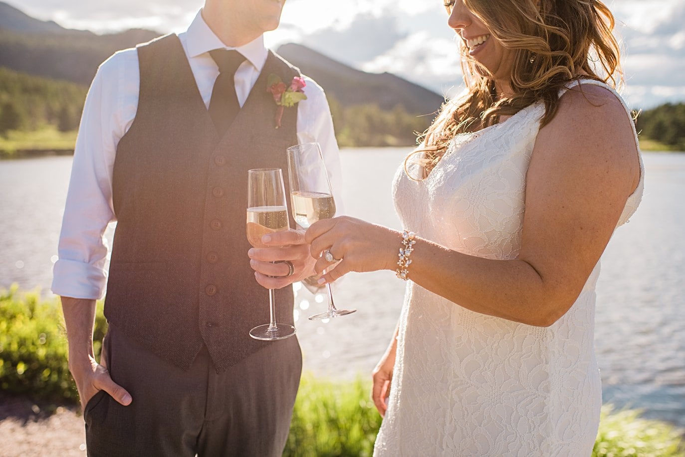 bride and groom toast with champagne at Lily Lake Elopement by Estes Park elopement photographer Jennie Crate