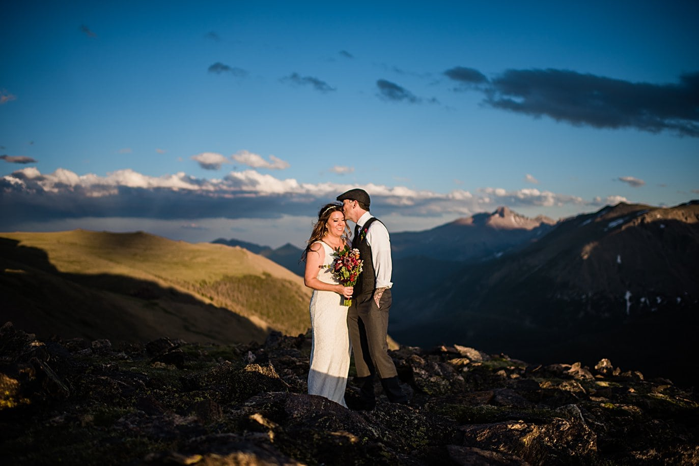 bride and groom wedding day portrait with Longs Peak at Rocky Mountain National Park elopement by Boulder elopement photographer Jennie Crate