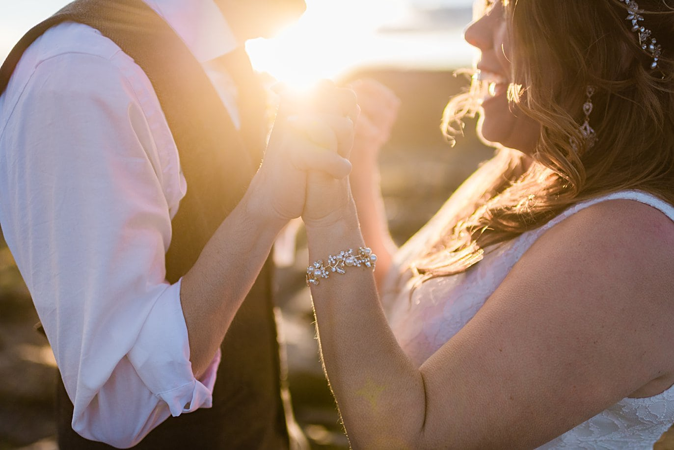 bride and groom celebrate at sunset at Rocky Mountain National Park elopement by Boulder elopement photographer Jennie Crate
