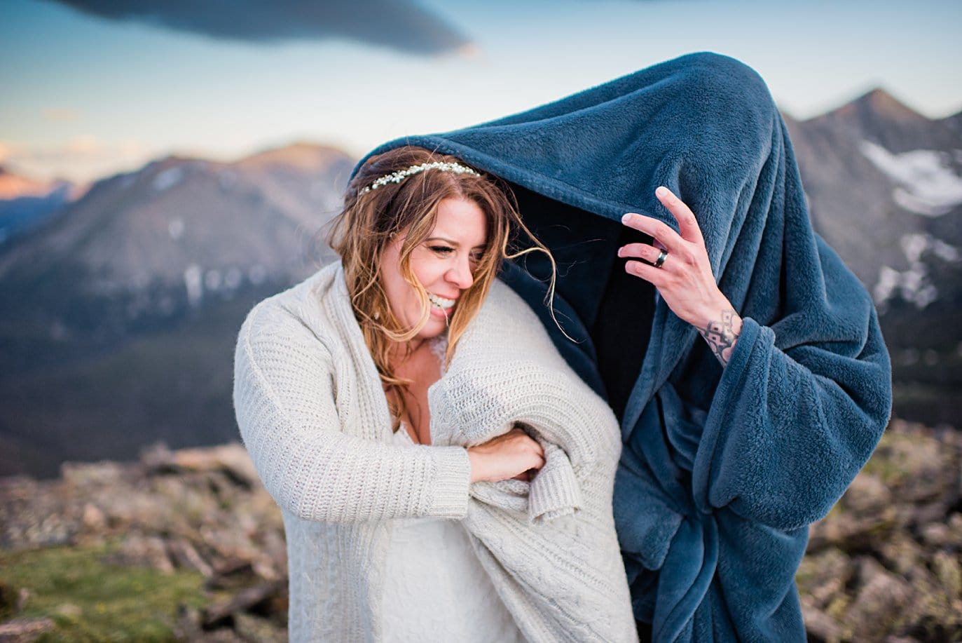 bride and groom put on blankets at Rocky Mountain National Park elopement by Boulder elopement photographer Jennie Crate