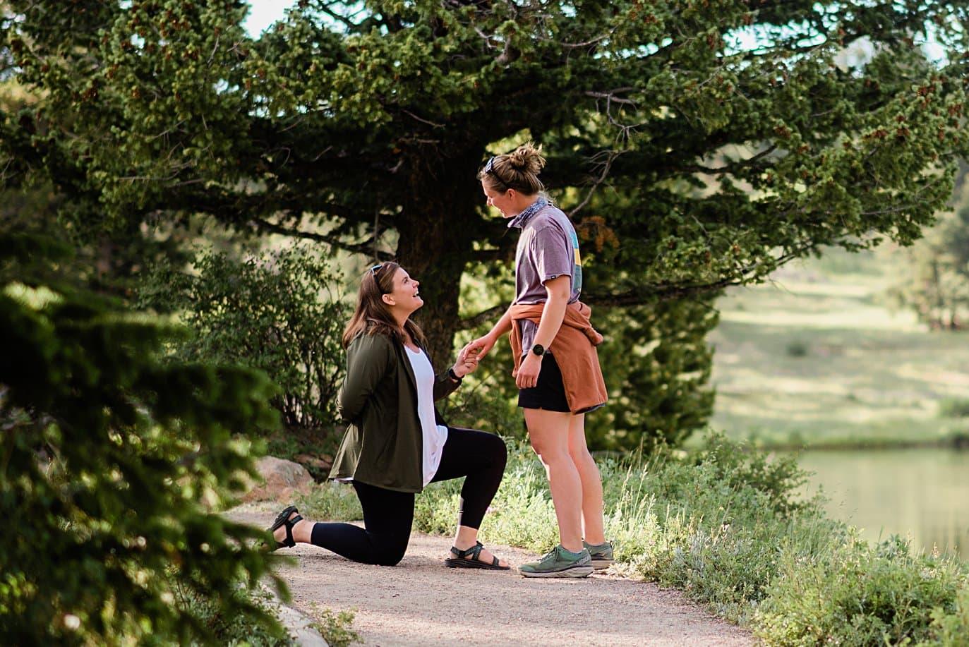 LGBTQ proposal at Estes Park Lily Lake by Estes Park wedding photographer Jennie Crate