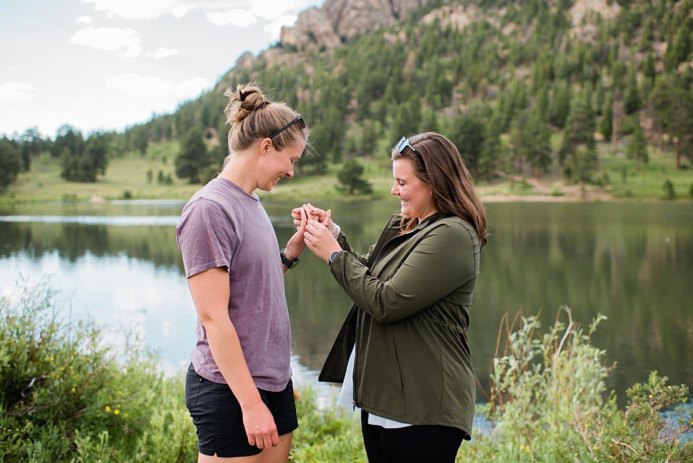 brides check out ring after Estes Park Lily Lake by Estes Park wedding photographer Jennie Crate