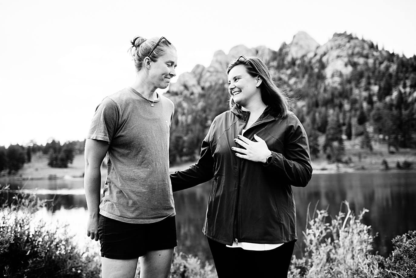 brides take in moment of proposal at Estes Park Lily Lake by Estes Park wedding photographer Jennie Crate