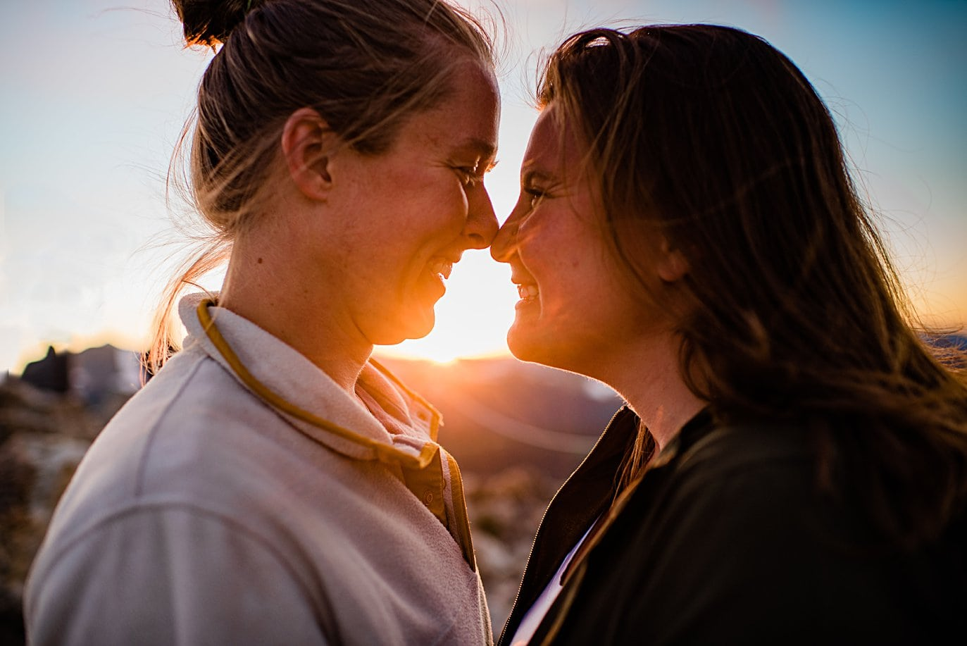 intimate LGBTQ sunset portrait at Rocky Mountain National Park engagement session by Colorado Gay Wedding photographer Jennie Crate