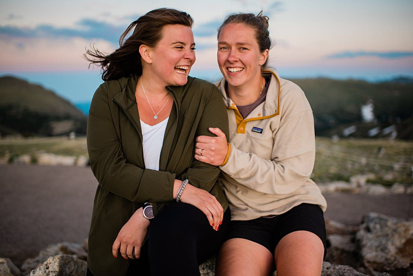 two brides excited about being engaged at Rocky Mountain National Park engagement session by Colorado Gay Wedding photographer Jennie Crate
