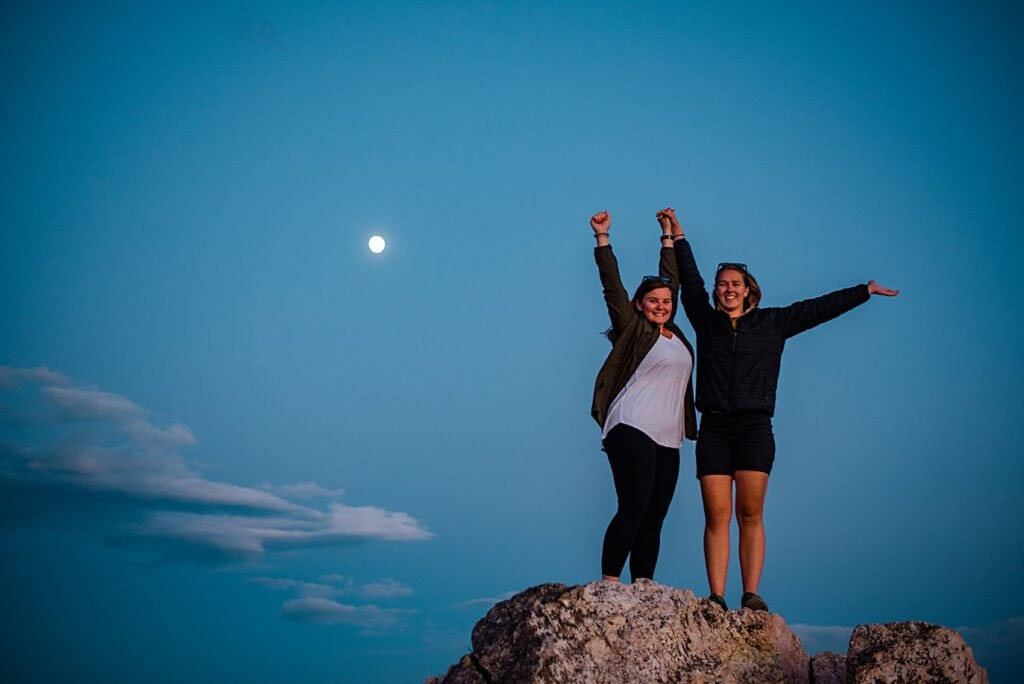newly engaged brides celebrate at twilight at Rocky Mountain National Park engagement session by Colorado Gay Wedding photographer Jennie Crate