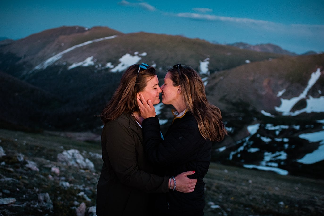 couple kisses at sunset on top of trail ridge road by Colorado LGBT wedding photographer Jennie Crate