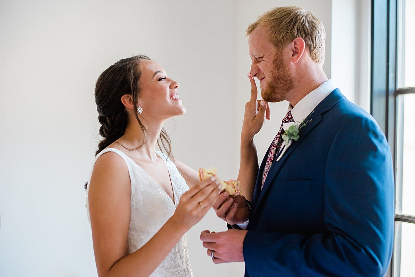 bride and groom sharing cookies and icing at dessert table at Walker Fine Art Gallery Wedding by Boulder Wedding Photographer Jennie Crate