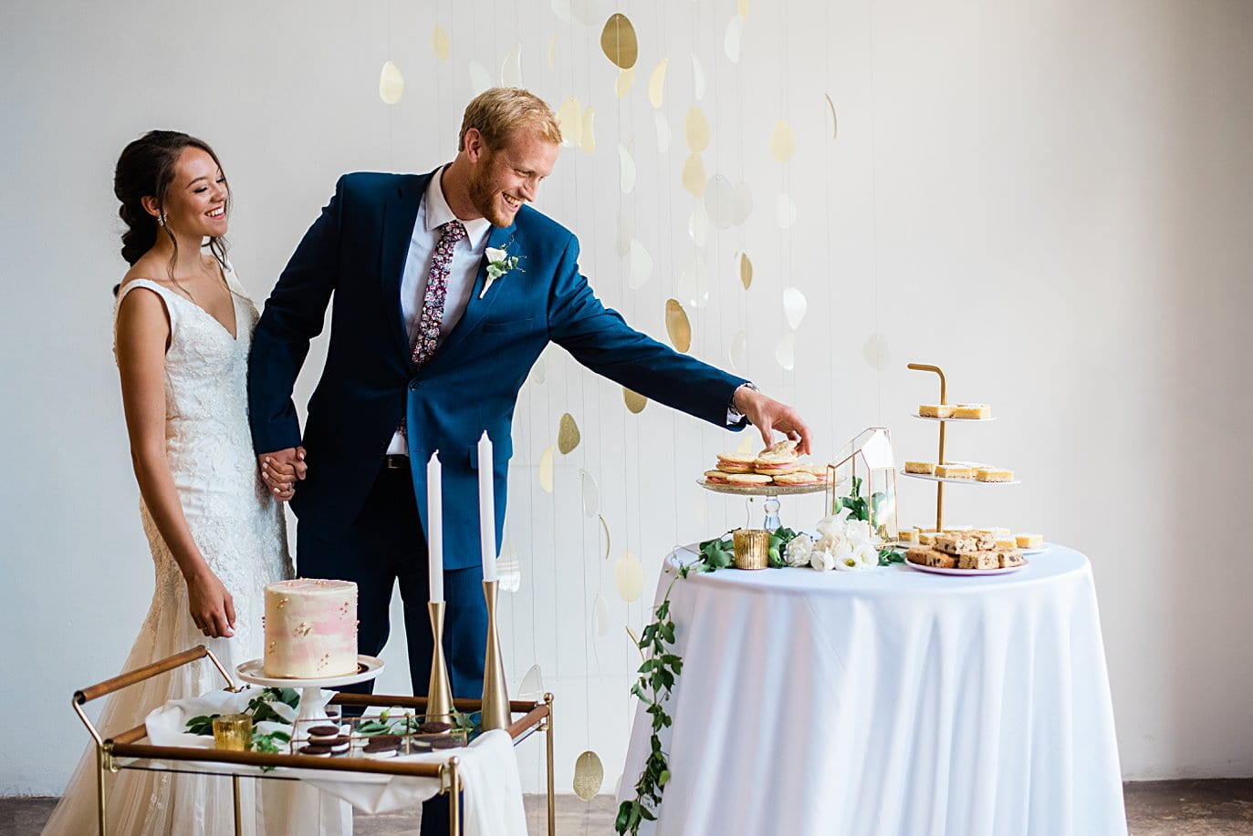 bride and groom grab desserts from dessert station at Walker Fine Art Gallery Wedding by Boulder Wedding Photographer Jennie Crate