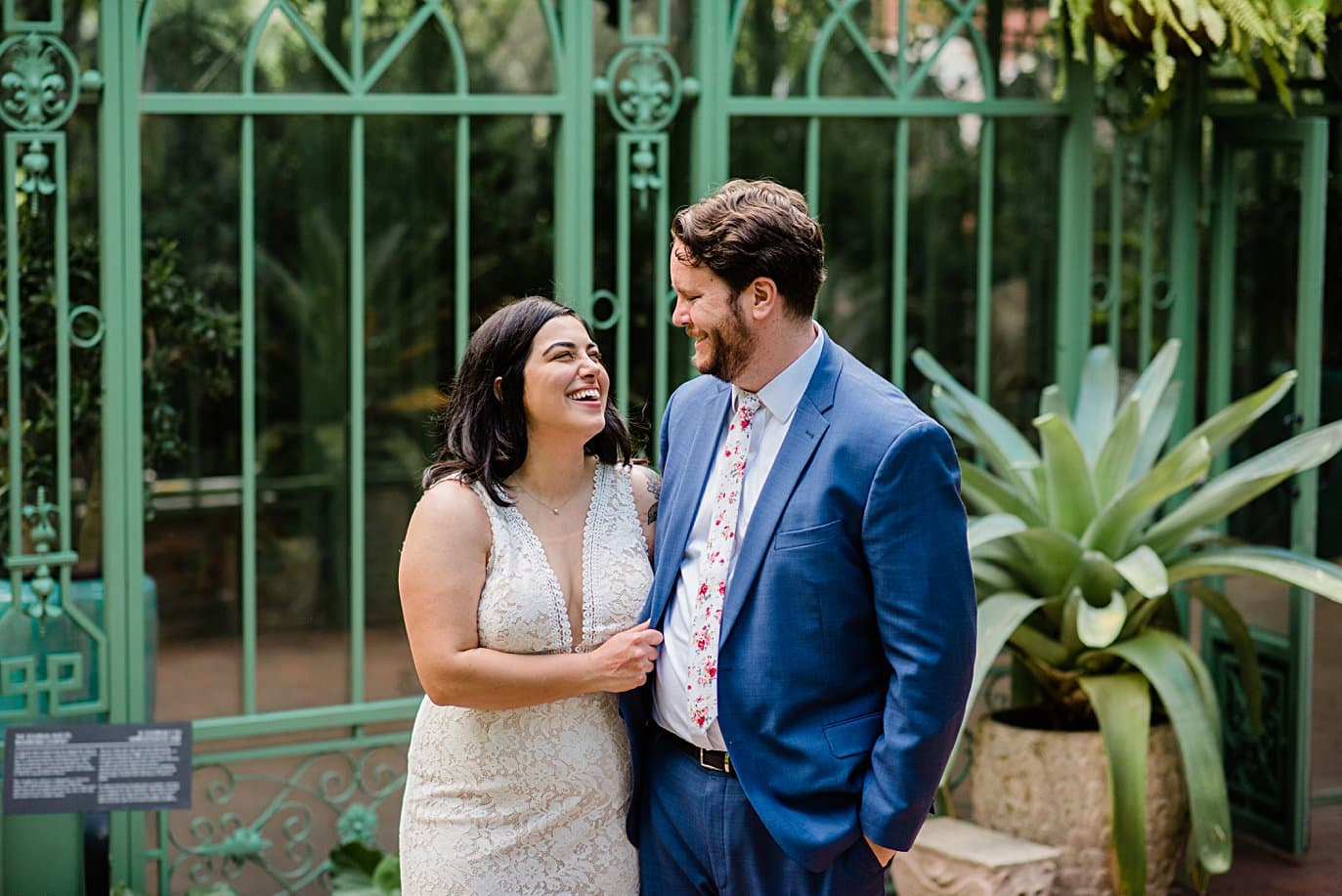 bride and groom in front of Woodland Mosaic wedding ceremony location at Denver Botanic Gardens wedding by Denver Wedding Photographer Jennie Crate