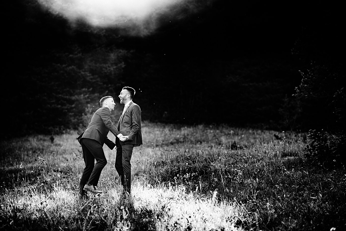grooms in dusky sunlight at Breckenridge Elopement by Colorado gay wedding photographer Jennie Crate