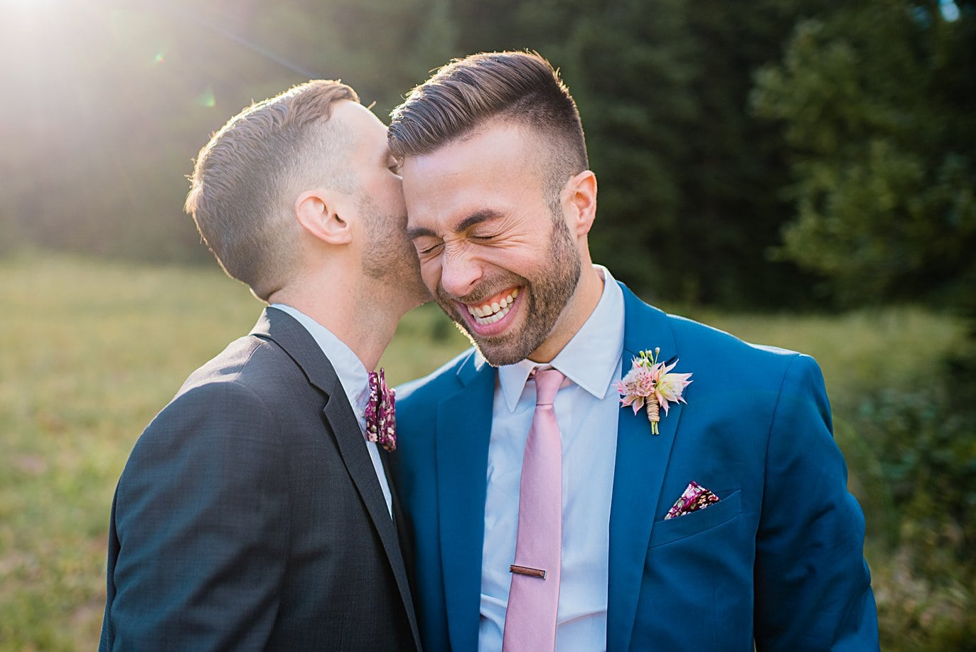 grooms laughing together at Breckenridge Elopement by Colorado gay wedding photographer Jennie Crate