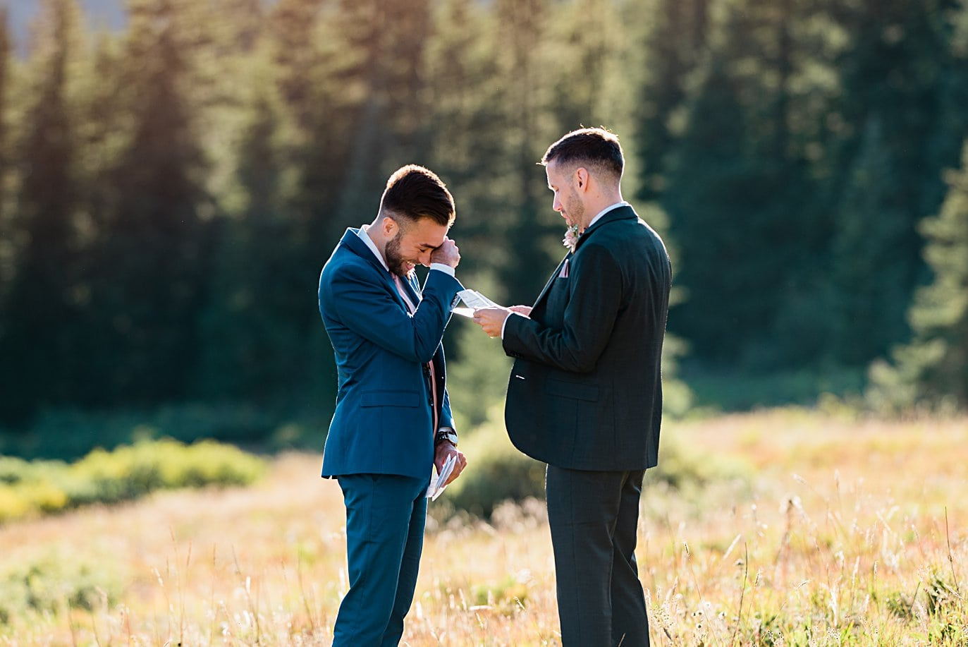 two grooms in custom suits share emotional vows at Breckenridge Elopement by Colorado gay wedding photographer Jennie Crate
