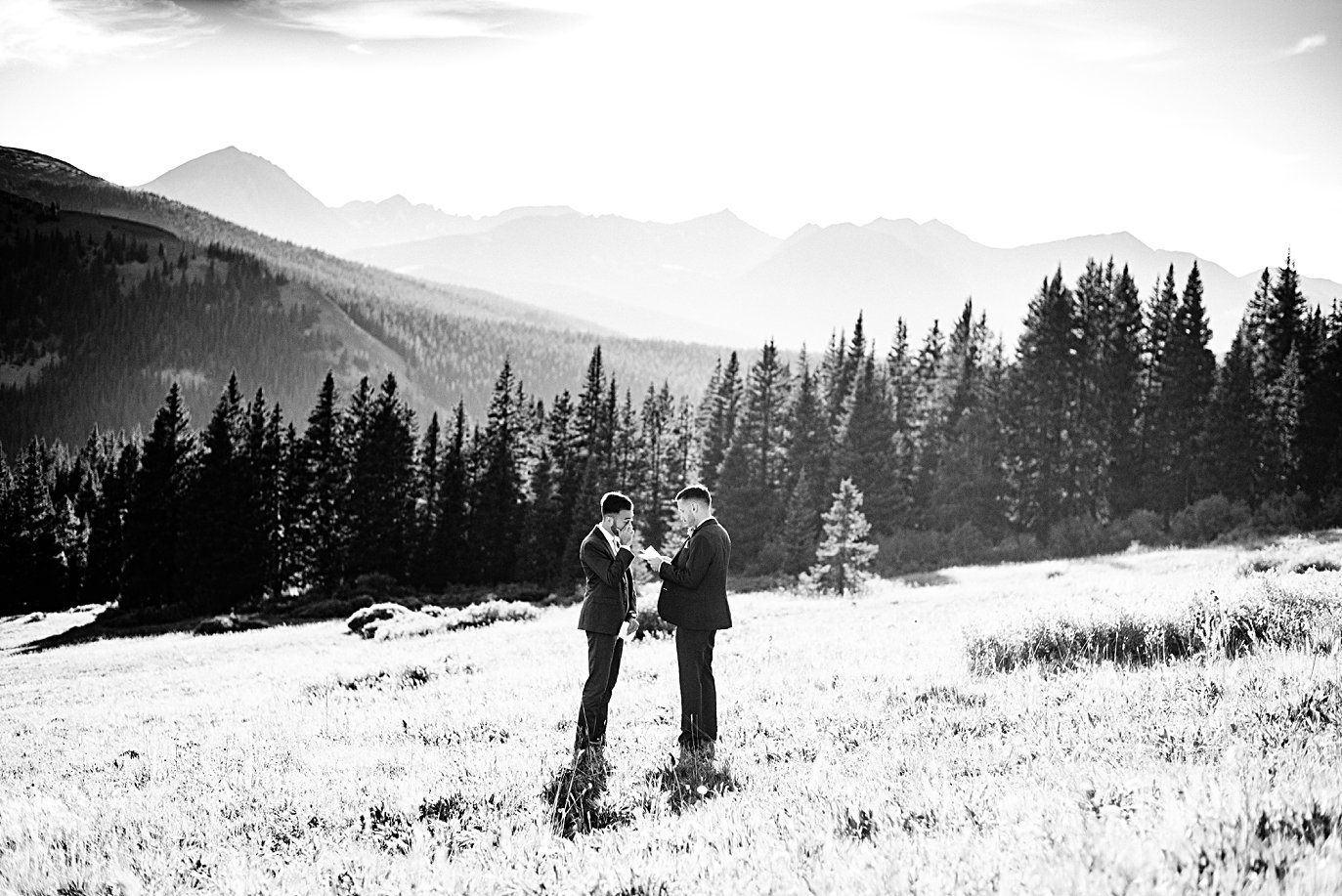 two grooms exchange vows in meadow at Breckenridge Elopement by Colorado gay wedding photographer Jennie Crate