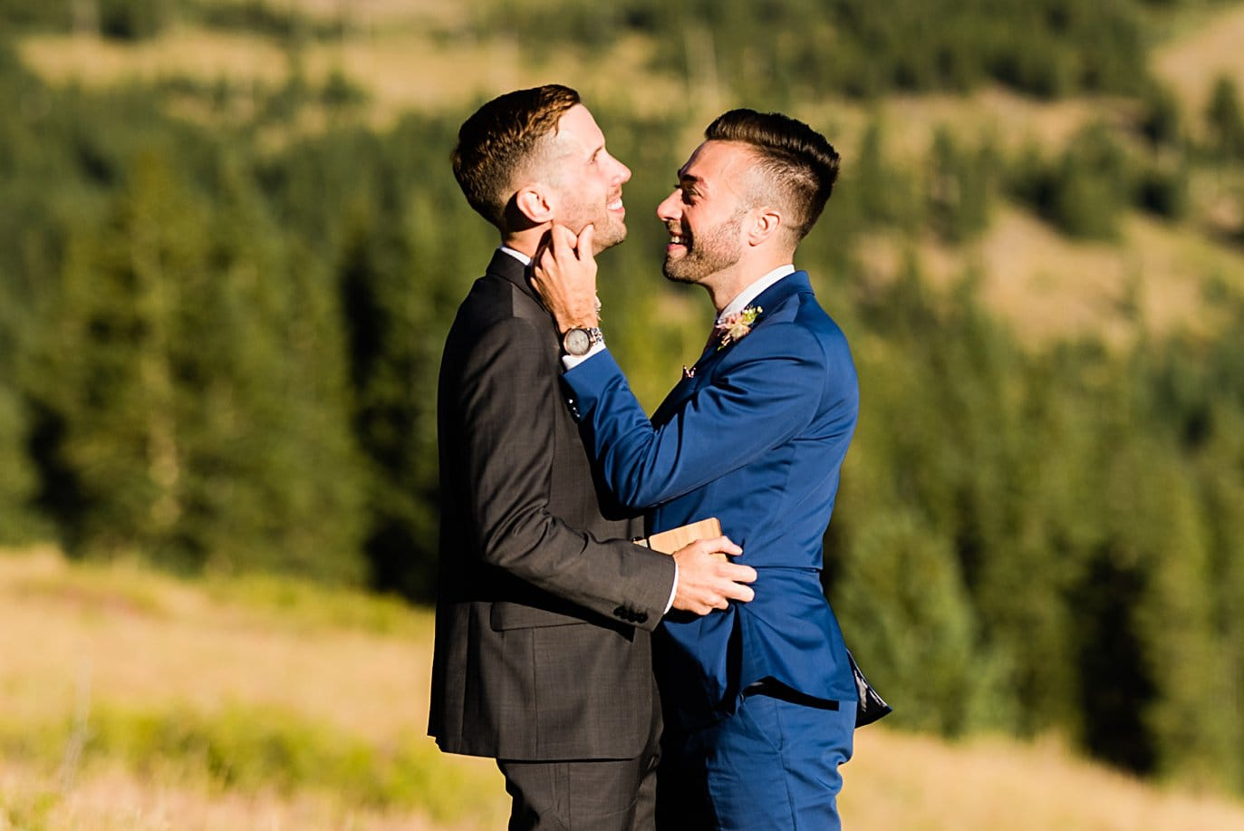 two groom share moment during self-solemnized ceremony at Breckenridge Elopement by Colorado gay wedding photographer Jennie Crate