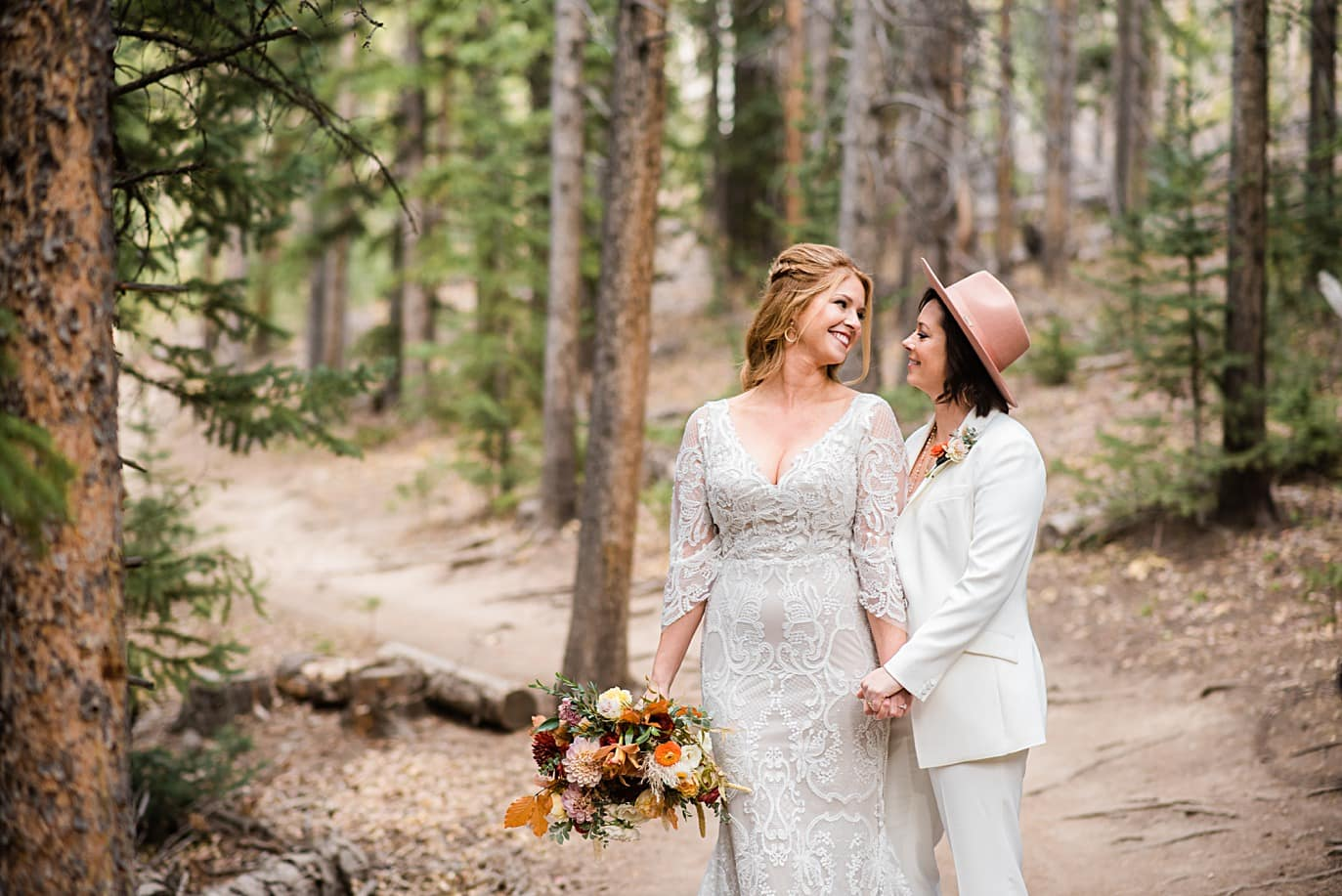 two brides in forest at Boreas Pass microwedding by Breckenridge wedding photographer Jennie Crate