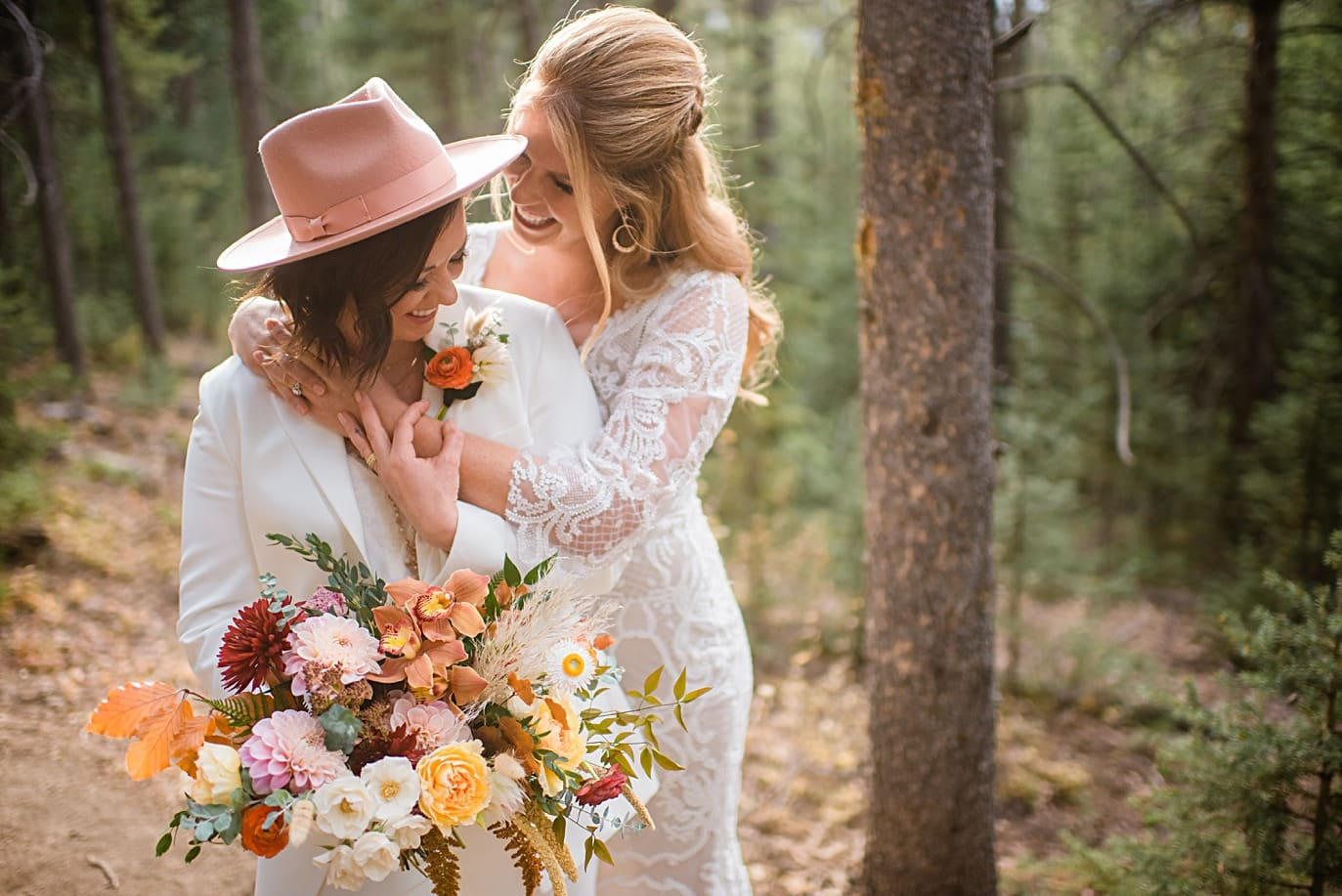 bride in pink hat at Breckenridge microwedding by Colorado LGBT wedding photographer Jennie Crate