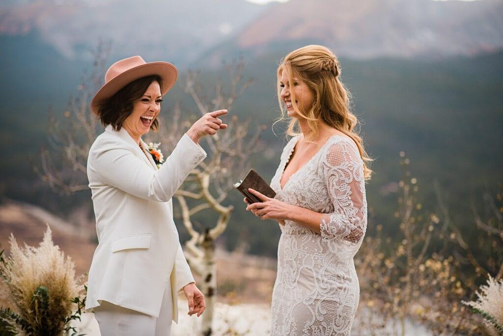 brides laugh through ceremony at Boreas Pass microwedding by Colorado gay wedding photographer Jennie Crate
