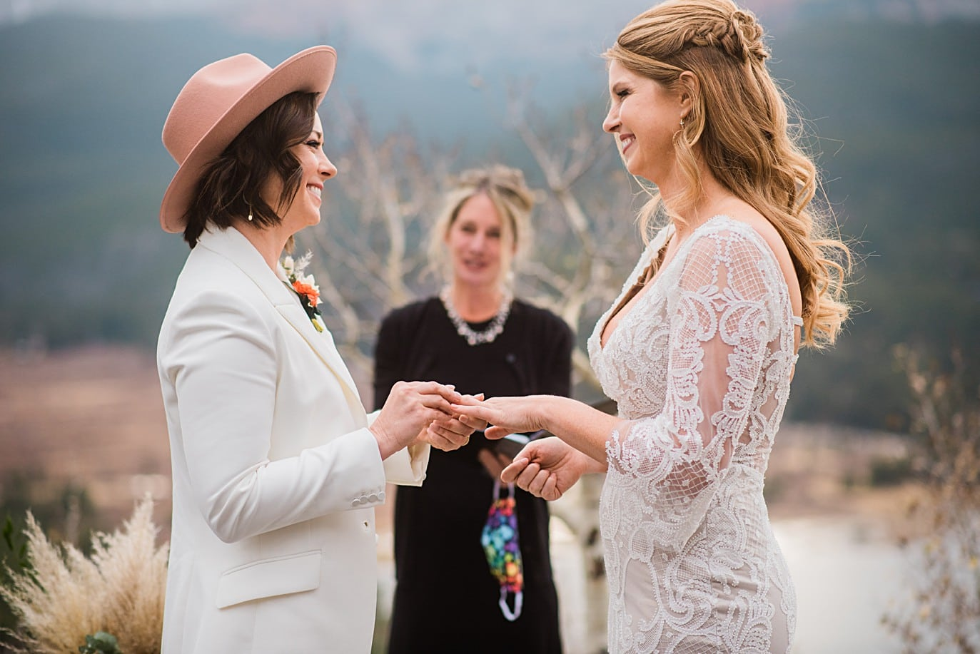 two brides exchange rings at Boreas Pass microwedding by Colorado gay wedding photographer Jennie Crate