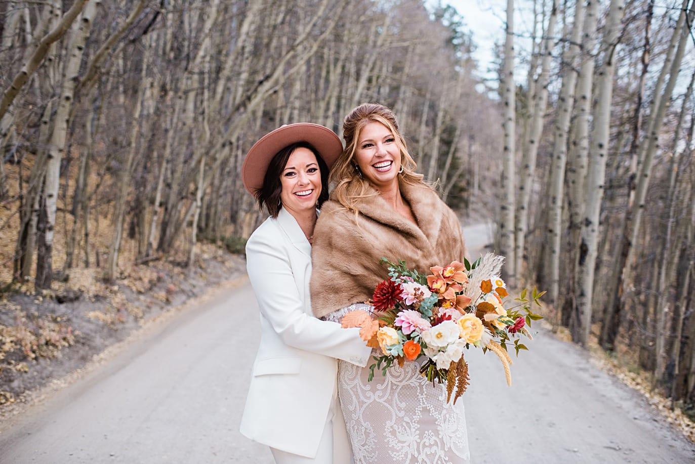 two brides along Boreas Pass road at Breckenridge microwedding by Breckenridge wedding photographer Jennie Crate