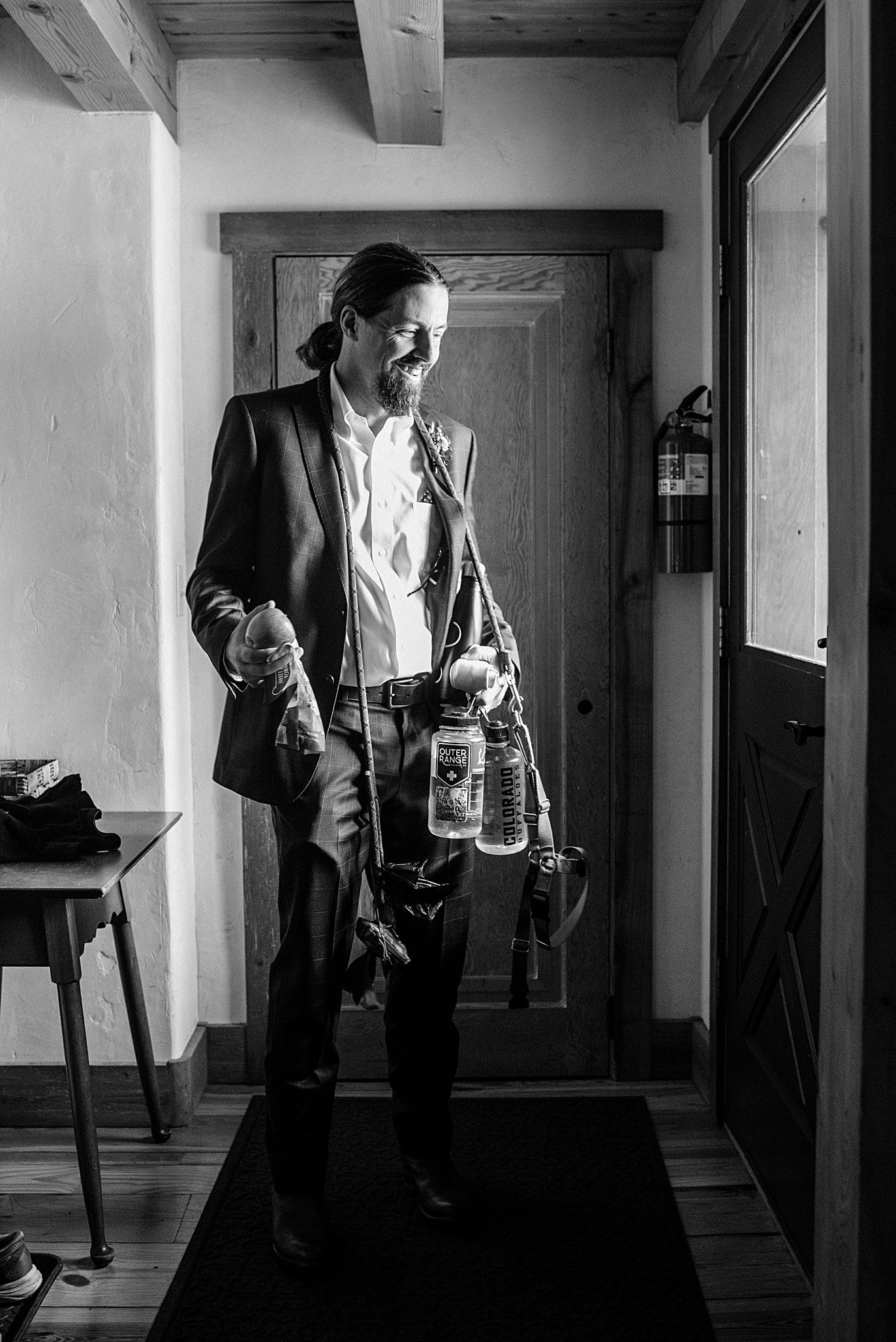 groom gets ready for elopement with snacks, water, and dog treats at Crested Butte Elopement by Crested Butte elopement photographer Jennie Crate