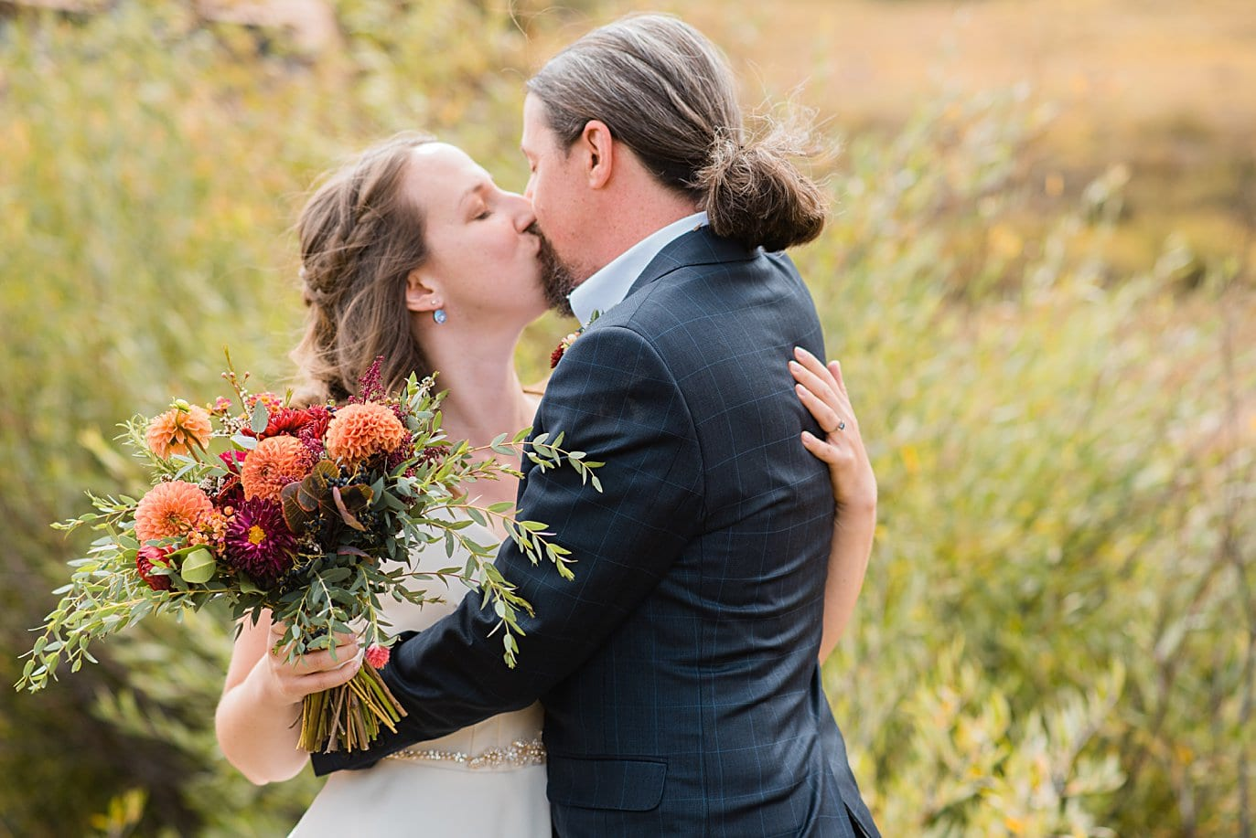 first look between bride and groom at Crested Butte Elopement by Crested Butte elopement photographer Jennie Crate