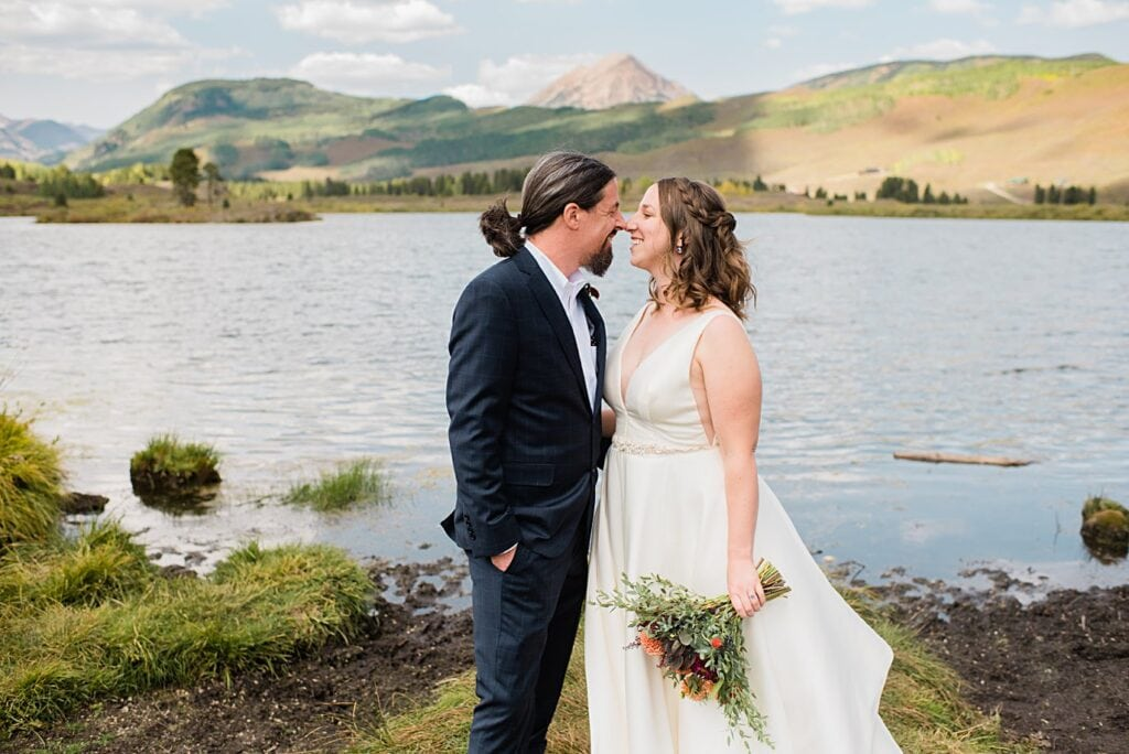 bride and groom cuddle after first look at Crested Butte Elopement by Crested Butte elopement photographer Jennie Crate