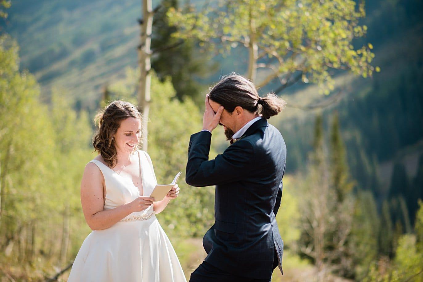 bride and groom laugh through wedding in Colorado by Colorado wedding photographer Jennie Crate