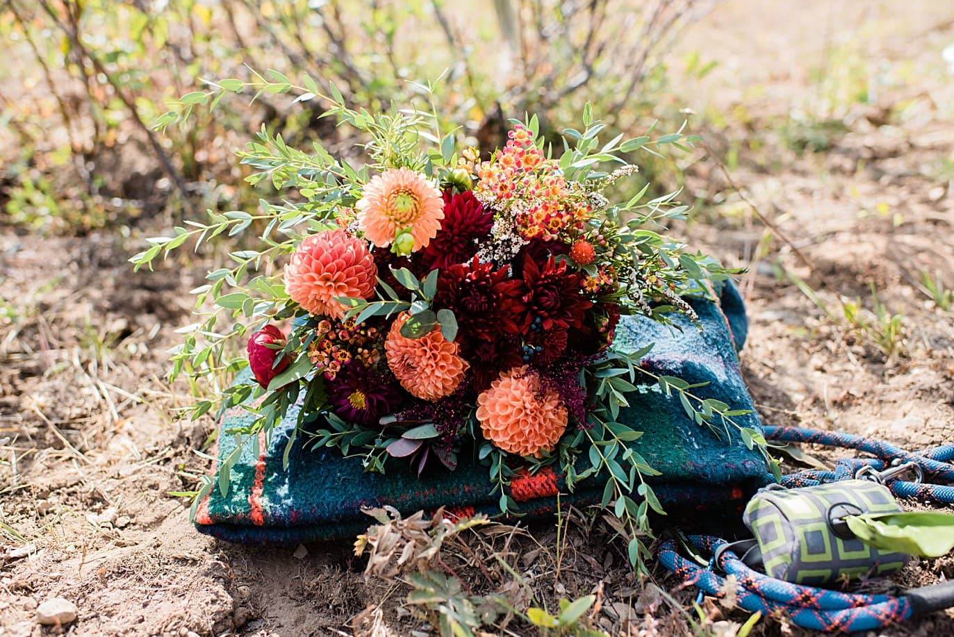 fall bridal bouquet with dahlias and picnic blanket
