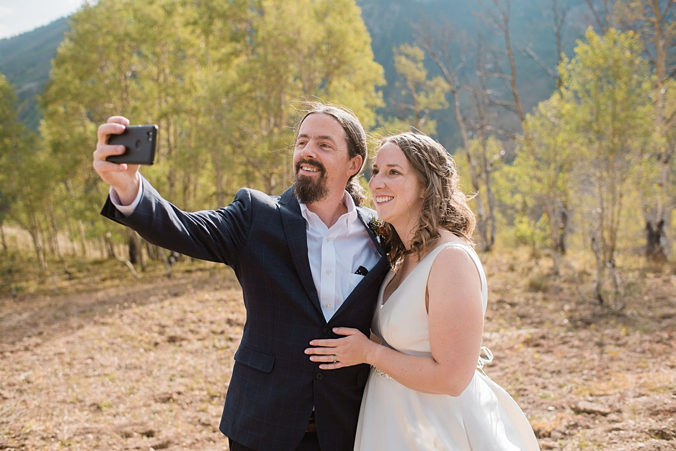 bride and groom selfie after wedding ceremony in Crested Butte by Denver wedding photographer Jennie Crate