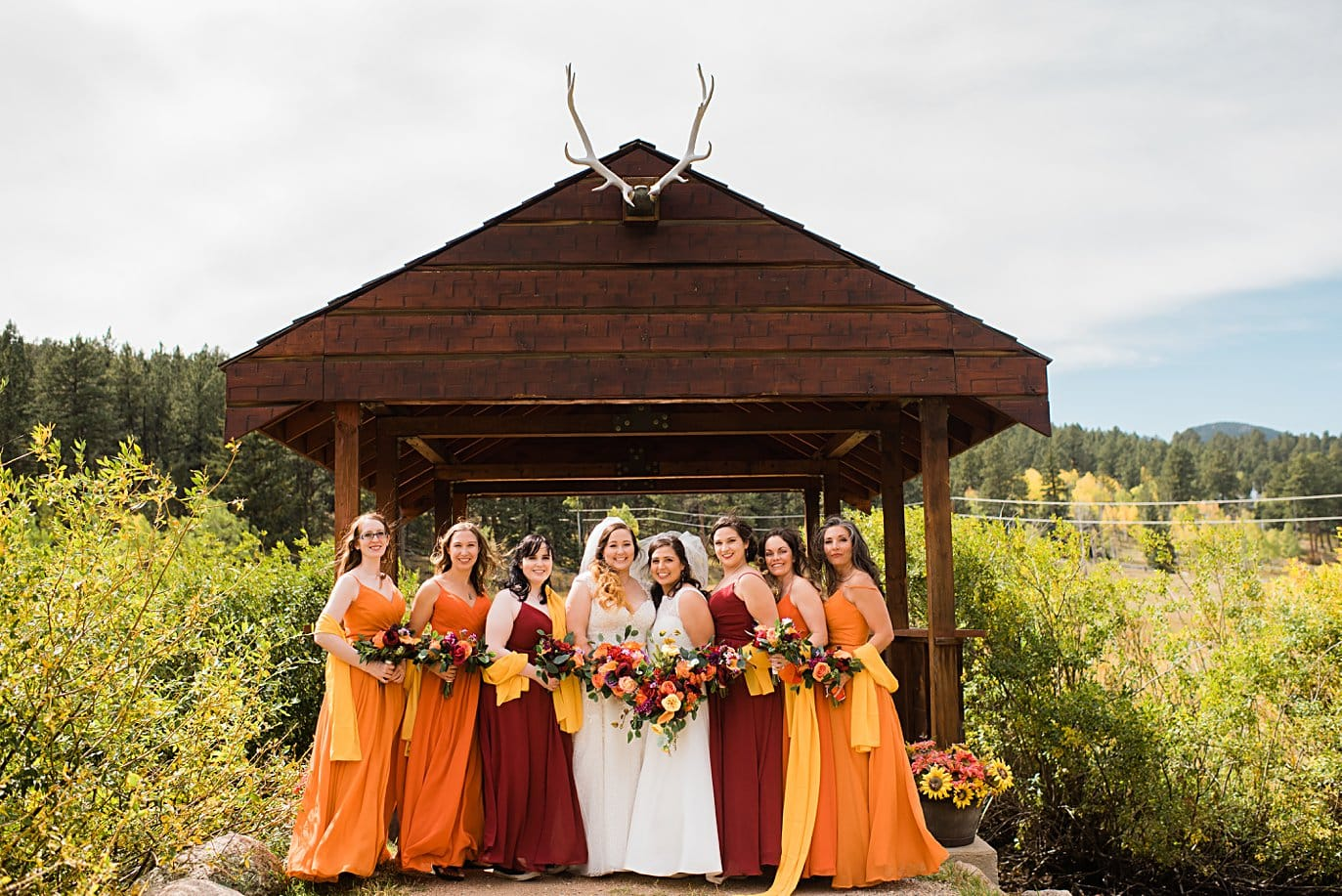 ombre bridesmaids dresses in fall colors at Deer Creek Valley Ranch wedding by Conifer wedding photographer Jennie Crate